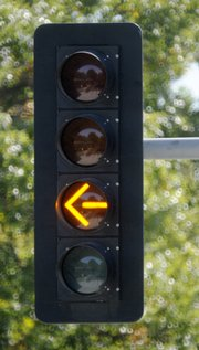 A new left-turn signal for traffic on Louisiana Street, turning east onto 19th Street displays a flashing yellow and then solid yellow for left turns. Signals like this are the first in Lawrence and are supposed to be easier for motorists to understand.