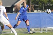 Kansas University's Shannon Mccabe connects on a lengthy side shot on goal in the first half. The Jayhawks beat Texas A&M, 1-0, on Friday at Jayhawk Soccer Complex. The victory over No. 6 Texas A&M was the highest-ranked opponent a KU team ever has defeated.