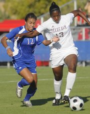 Lauren Jackson, left, battles for position to the ball against a Texas A&M player in the Jayhawks' game at the Jayhawk Soccer Complex Friday, Oct. 17, 2008.