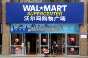 Customers leave a Wal-mart supercenter June 20 in Loudi, Hunan Province, China. Maoming, Wuhu and Loudi are Chinese cities so far in the boonies that the popular Lonely Planet travel guide doesn't even mention them, but retailers are seeking opportunities for growth there.