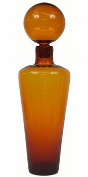This 29-inch-high orange glass bottle with stopper is unsigned, but it was probably made by Blenko Glass Co. Orange was a popular color in the 1960s. The bottle sold for $540 at a Treadway/Toomey auction in Oak Park, Ill.