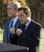 French President Nicolas Sarkozy, right, speaks about the world economy with President Bush on Saturday at Camp David, Md.