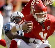 Kansas City Chiefs quarterback Damon Huard (11) is sacked by Tennessee Titans defensive tackle Albert Haynesworth.