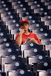 In this Oct. 4, 2007, file photo, a Philadelphia Phillies fan sits in the stands after the Phillies lost to the Colorado Rockies, 10-5, in Game 2 of the National League division series in Philadelphia. The Phillies are the losingest team in pro sports history.