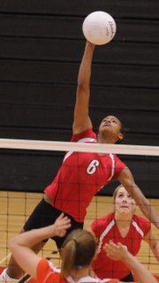 Lawrence High senior Tayler Tolefree gets up for a spike against Olathe East during the Lions' first match. LHS lost to O-East, 25-17, 25-20, on Tuesday at Lawrence High. It was the last home match of the season for the Lions, and an all-senior lineup played together for 62 straight points.