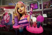 Barbie Fashion and Beauty from Mattel is displayed at the American International Toy Fair in New York in this Feb. 14 file photo. Toy maker Mattel Inc. has raised its prices for this Christmas shopping season and warns that more increases are likely to follow next year.