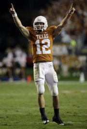 Texas' Colt McCoy (pictured), Oklahoma's Sam Bradford and Missouri's Chase Daniel are part of the new wave of Big 12 quarterbacks who have taken the conference's offenses to a new level. Coaches said the days of lockdown defenses in the conference could be gone for good.