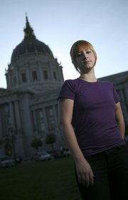 Prostitute Patricia West, 22, poses for a photograph Friday in front of City Hall in San Francisco. San Francisco would become the first major U.S. city to decriminalize prostitution if voters next month approve Proposition K, which forbids local authorities from investigating, arresting or prosecuting anyone for selling sex.