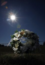 A wreath sits near Farm Road 2648 where Brandon McClelland died Friday near Paris, Texas. Brandon was on a late-night beer run across state lines to Oklahoma with two white friends and ended up dead on a rural Texas road. Authorities say he was run over by a pickup and then dragged as far as 70 feet beneath the truck.