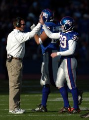 Clint Bowen, left, was a player at Kansas University who worked his way up the ranks as an assistant coach. He's about to enter his second season as the Jayhawks' defensive coordinator.