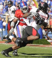Texas Tech receiver Detron Lewis pulls in a pass before being brought down by Kansas safety Darrell Stuckey during the second quarter Saturday, Oct. 25, 2008 at Memorial Stadium. The play helped set up a Red Raider touchdown.