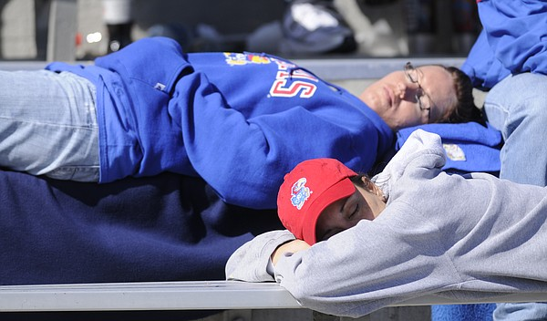 A blowout game puts a pair of Jayhawk fans to sleep in the stands at Memorial Stadium during homecoming against Texas Tech on Saturday, Oct. 25, 2008.