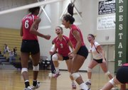 From left, Lawrence High's Tayler Tolefree, Kiely Mosiman, Jasmyn Turner and Katlyn Green celebrate their first-set victory over Free State. LHS swept the Firebirds and then beat Shawnee Mission North on Saturday at FSHS to earn a trip to state.