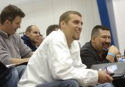 From left, Jon Granberry, Matt Cook and Pete Herrera, all of Russell, listen to a coach speak Saturday, Oct. 25, 2008 during a Bill Self coaching clinic at Horejsi Family Athletic Center.