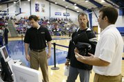 Brent Boyle, left, and Michael Coggins, right, both of Lawrence, talk with Chris Rich, of Cambridge, Neb., about sports camps on Saturday during Bill Self's coaches clinic at Horejsi Family Athletic Center.