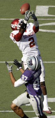 Oklahoma's Brian Jackson (2) breaks up a pass intended for K-State's Deon Murphy. Oklahoma defeated K-State, 58-35, on Saturday in Manhattan.