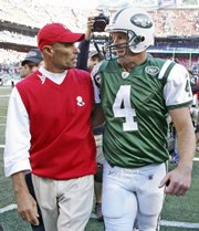 Kansas City Chiefs coach Herm Edwards, left, and New York Jets quarterback Brett Favre talk while walking off the field.
