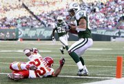 New York Jets wide receiver Laveranues Coles (87) makes a fourth-quarter reception for a touchdown around Kansas City Chiefs cornerback Dimitri Patterson. The Jets won, 28-24, Sunday in East Rutherford, N.J.