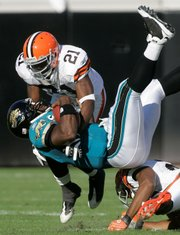 Jacksonville Jaguars quarterback David Garrard, center, is upended by Cleveland safety Brodney Pool, top, and Cleveland Browns safety Sean Jones. Cleveland topped Jacksonville, 23-17, on Sunday in Jacksonville, Fla.
