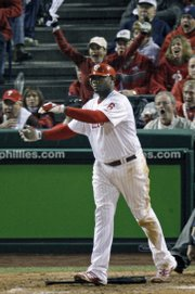 The Philadelphia Phillies' Ryan Howard (6) watches his two-run home run off Tampa Bay relief pitcher Trever Miller. Howard homered twice in the Phillies' 10-2 victory over the Rays on Sunday in Philadelphia. The Phillies took a 3-1 lead in the World Series.