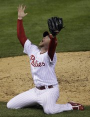 Philadelphia Phillies pitcher Brad Lidge reacts after the final out in Game 5 of the World Series. The Phillies defeated the Tampa Bay Rays, 4-3, to win the series Wednesday in Philadelphia. Story, page 5B