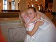 Alyx, 3, left, celebrates with her big sister, Cameron Wood, 8, after Cameron's first communion. They are the daughters of Brent and Britny Wood, Lawrence. Britny Wood submitted the picture.