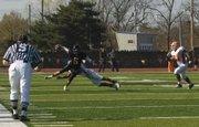 Baker senior wide receiver James Hensley (5) evades Missouri Valley defenders in Baker's 26-22 victory Saturday in Baldwin City.