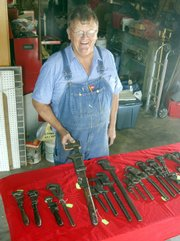 Evan Johnson knows the inside story of virtually all of the wrenches in his collection, displayed at his home in Walton. Johnson estimates he has collected about 2,500 tools, and is particularly fond of his wrenches.