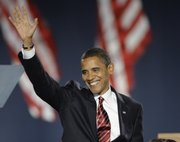 President-elect Barack Obama waves as he takes the stage at his election night party in Chicago&#39;s Grant Park, Tuesday, Nov. 4, 2008.