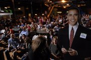 A life-sized cutout is carted into Abe and Jake's Landing on election night on Tuesday, Nov. 4, 2008.