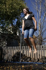 Megan McReynolds,  11, bounces on her family's trampoline, purchased about four years ago.