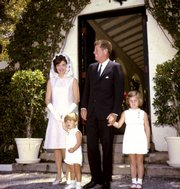 This April 14, 1963, file photo shows President John F. Kennedy and family outside the Palm Beach, Fla., home of the president's father after a private Easter Service. From left are first lady Jacqueline Kennedy, John Jr., 3, President Kennedy, and Caroline, 5.