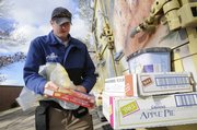 Schuyler Smith, Topeka, unloads a delivery of frozen foods from his Schwan's truck while on a delivery route in Lawrence.