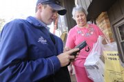 Schuyler Smith, a Schwan's food delivery driver, drops off groceries for Kay Rytting, Lawrence.