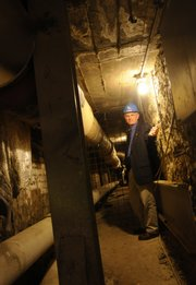 Jim Modig stands inside one of the more than 100-year-old steam tunnels beneath the KU campus. Tunnels in the worst shape are being replaced but the majority of the network will continue to be used in its current state.
