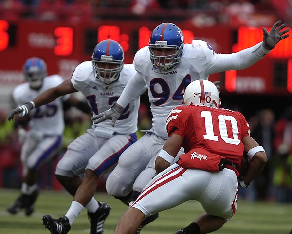 Nebraska running back Roy Helu (10) puts a move on Kansas defensive tackle Caleb Blakesley (94) and Kansas linebacker James Holt (12) during the first quarter Saturday, Nov. 8, 2008 at Memorial Stadium in Lincoln.