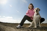 Lawrence dental hygienist and marathon runner Marsha Odgers, pictured with her occasional running partner, Ellie, developed her own line of clothing called Run~Girl.