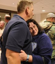 Mark Griffith Sr. hugs his sister, Patricia Castelman, after the sentencing of Ramona Morgan in the death of Griffith's son, Rolland Griffith. Morgan was sentenced to 26 years for killing Griffith and Ty Korte on Sept. 11, 2007, as they worked on U.S. Highway 59.