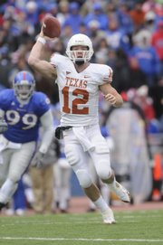 Colt McCoy looks to pass against the Jayhawks in the second half. McCoy led the Texas Longhorns to a 35-7 win over Kansas at Memorial Stadium on Nov 15, 2008