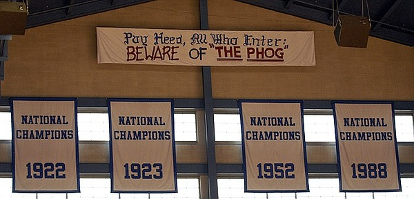"New, bigger banners memorializing Kansas University's national champions - and a new ""Beware of 'the Phog'"" banner - were unfurled in Allen Fieldhouse in this photo from July 2006. A new banner commemorating the 2008 national championship will join these four Tuesday night."