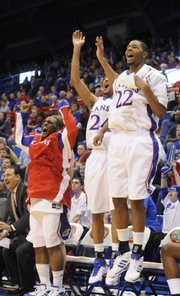 Kansas players Sherron Collins, left, Markieff Morris and Marcus Morris go wild after a three-pointer by guard Conner Teahan in the second half Tuesday, Nov. 18, 2008 at Allen Fieldhouse.