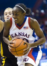 KU junior guard LaChelda Jacobs (00) works her way around the Iowa defense Tuesday during the Jayhawks' home 76-55 victory at Allen Fieldhouse.