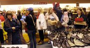 Shoppers line up to purchase shoes at Arensberg Shoes, 825 Mass., during the company's going out of business sale on Thursday, Nov. 20, 2008. The store is closing after 50 years in business.