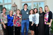 Lawrence Schools Foundation trustees and staff visit with Brian McClendon, engineering director for Google Inc., at a reception on Sept. 4 at the home of Bill and Cindy Self. From left are Becky Orth, Lee Beth Dever, Cindy Self, Brian McClendon, Rosy Elmore, Susan Esau, Paige Hofer and Andrea Moen.