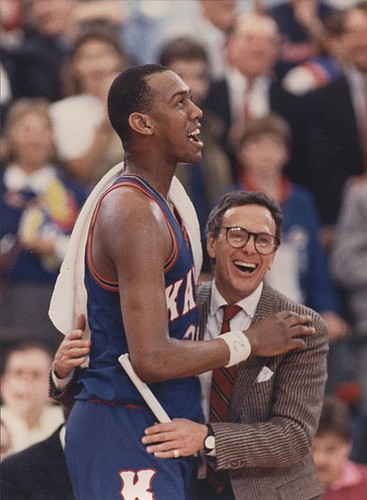 Danny Manning and Larry Brown embrace after clinching the 1988 Men's NCAA Basketball title.