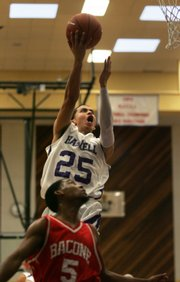 Haskell point guard Solomon Horse Chief leaps for a layup Saturday at Haskell.