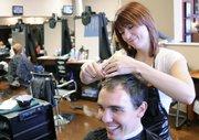 Student stylist Krystal Smith, Olathe, trims the hair of client Clay Meyer, Blue Springs, Mo., at Z Hair Academy, 2429 Iowa.