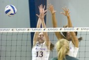 Nicole Tate, left, and Natalie Uhart go up to block a Baylor spike Wednesday, Nov. 26, 2008 during the Jayhawks' home game at Horejsi Family Athletic Center.