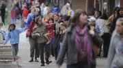 Shoppers walk the sidewalks of downtown Lawrence on Black Friday, Nov. 28, 2008. Shoppers were in line as early as 4 a.m. at some stores for the start of Black Friday, the busy shopping day after Thanksgiving.