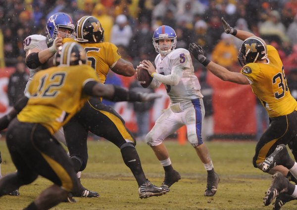 Kansas quarterback Todd Reesing looks to pass through the Missouri defense during the fourth quarter Saturday, Nov. 29, 2008 at Arrowhead Stadium.